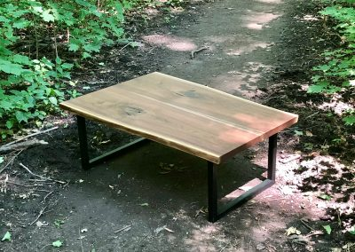Book matched black walnut coffee table with black steel legs